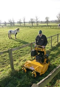 About - Wright stander mower alongside fences