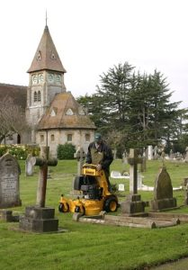 About - Wright stander mower in cemetery